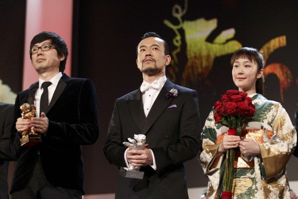 Actor Liao Fan actress Kuroki and director Diao Yinan pose with their prizes during awards ceremony of 64th Berlinale International Film Festival in Berlin